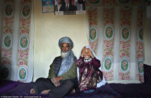 A 55 year old Afghani man with his 8 year old bride on the day of their engagement.